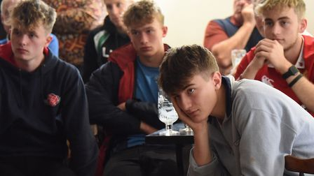 Sad England fans as they watch the end of the England against South Africa world cup final match at
