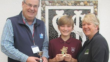 Solana UK managing director Craig Stephens presents a best yield cup to Sheringham High School Year