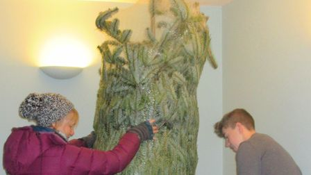 Beverley Bishop and her son Jess Fairweather, setting up a Christmas tree. Picture: Supplied by Beve