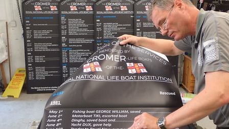 Launch boards being replaced at Cromer. Steve Soanes preparing to add details to the boards. Picture