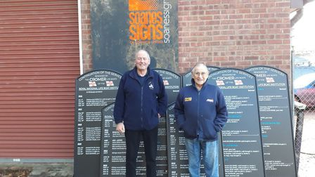 Derek Hinds, Chairman of RNLI Cromer, and Ted Luckin, RNLI Cromer boathouse officer, with the boards