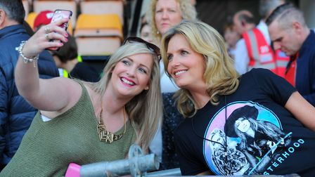 Rod Stewart's wife Penny Lancaster, right, near the mixing desk, when her husband played at Carrow R