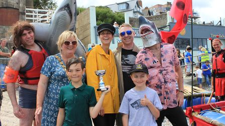 Sheringham Playpark Revamp crew with their Jaws-inspired craft, which won wackiest raft trophy in th