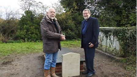 Dougie Whitwood, who restored the original grave, with Revd Dally. Pictures Robert Barker