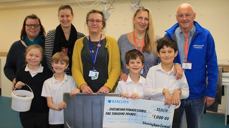 Sheringham Carnival chairman Stuart McClean presenting a cheque for £1,000 to Sheringham Primary Sc
