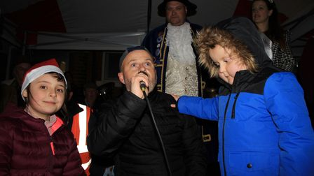 Six-year-old Benny Pitcher on stage with his dad Kevin at Sheringham Christmas lights switch-on.Phot