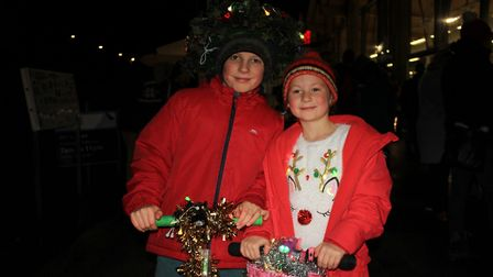 Nine-year-old Jonny and his sister Ivy on their illuminated scooters.Photo: KAREN BETHELL