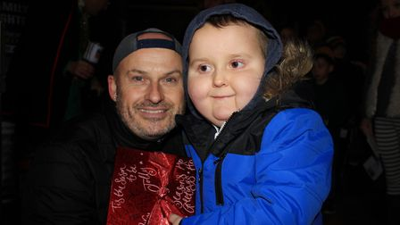 Kevin Pitcher with his six-year-old son Benny, who helped turn on the Christmas lights at Cromer.Pho