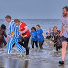 Swimmers taking part in the Poachers Pocket new year's dip at Bacton. Picture: Colin Cubitt