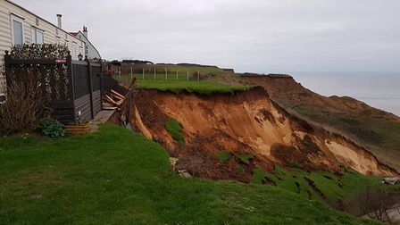 A huge section of cliff has fell onto the beach and sea at a caravan park in Trimingham in early Jan