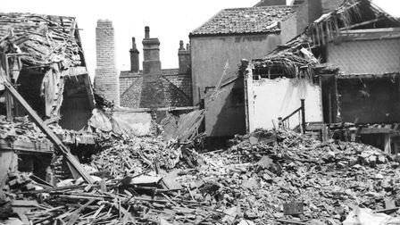 The corner of Church Street and High Street after the 1942 raid. The stick of bombs across the town