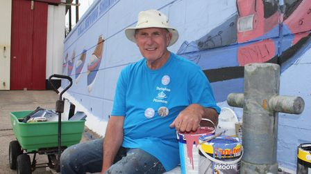 Colin Seal working on a mural marking the 150th anniversary of the RNLI. The well-known artist and
