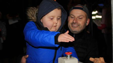 Benny switching on Cromer's Christmas lights with dad Kevin.Photo: KAREN BETHELL