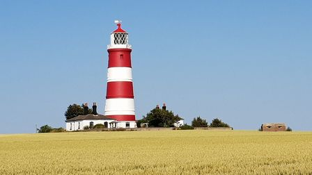 The Mammoth Marathon will pass by sites including the famous Happisburgh lighthouse. Picture: Stephe