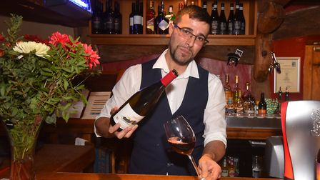 Manager Jose Manuel Cabrera Sanchez pours Spanish wine at The Walpole Arms in Itteringham. Pictures;