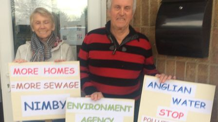 Judith Ford and Dennis Willis protesting outside Hoveton village hall at the exhibition to discuss p