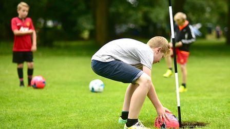 Youngsters enjoying pitch and kick footgolf at Eaton Park. Picture: ANTONY KELLY