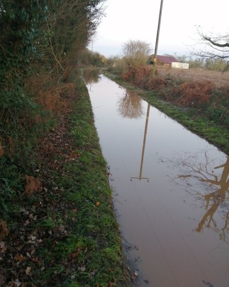 Broad Fen Lane in Dilham inundated after rain. Picture: Richard Woods