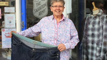 Sheringham charity shop worker Cindy Farrow with the size 28 jeans she wore before her amazing eight