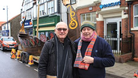 Viking Festival founder Colin Seal (left) with artist Brian Lewis, who painted a gold and copper lea