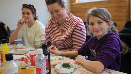Family fun at a t-shirt and tote bag designing workshop held at Sheringham Museum as part of the ann