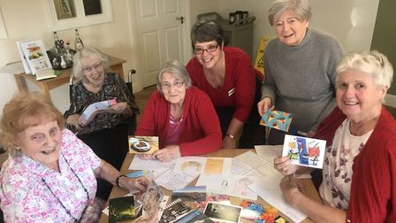 Nancy Bond-Webster (centre back), well-being lead at St Michaels Court in Aylsham, and residents Pat