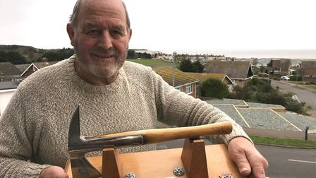 Will Cox, with his commemorative axe, has retired after 58 years with Norfolk Fire and Rescue Servic
