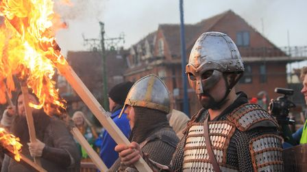 Flame torch-wielding warriors line the high street at Sheringham's Scira Viking Festival finale.Phot