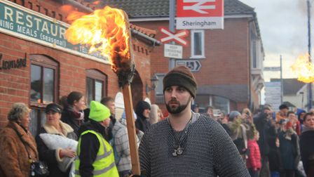 Flame torch-wielding warriors on parade at Sheringham's Scira Viking Festival finale.Photo: KAREN BE