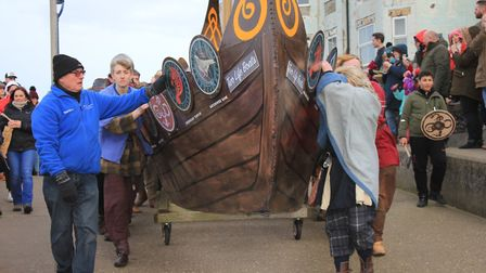Festival founder Colin Seal (left) accompanying the longship to the seafront for the ceremonial boat