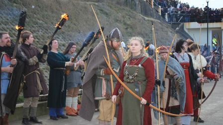 Flame torch-wielding warriors on the prom at Sheringham's Scira Viking Festival finale.Photo: KAREN