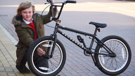 Eight-year-old Elias Jolly of Aylsham, with his new bike after his was stolen. Picture: DENISE BRADL