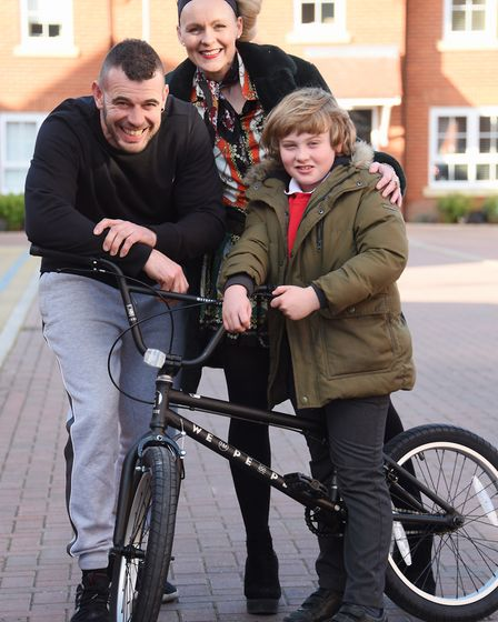 Eight-year-old Elias Jolly of Aylsham, with his new bike. With him are his parents, Malcolm and Cam