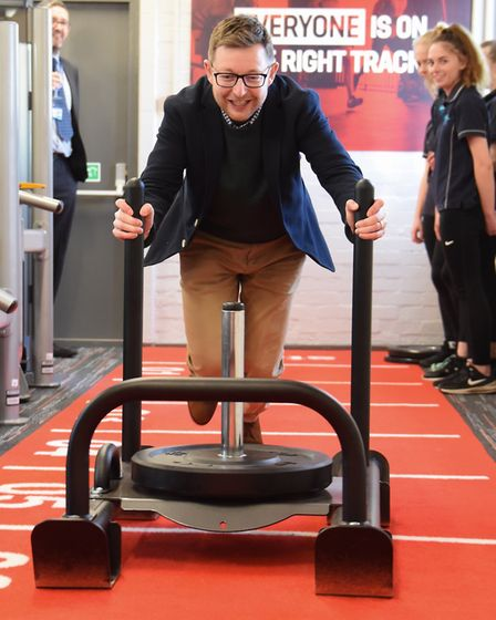 North Norfolk MP Duncan Baker tackles the sledge drag at the opening of the new Cromer Academy Gym.