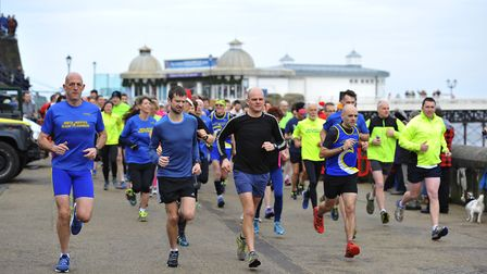 North Norfolk Beach Runners taking part in an event in front of Cromer Pier. Picture: MARK BULLIMORE