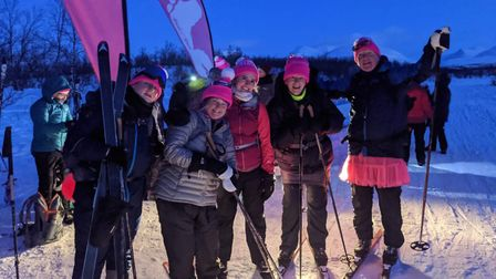 Alex Swift (centre) completed a two-day cross country skiing trek in Sweden for Walk the Walk breast