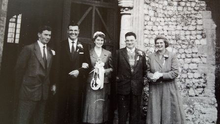 Pat and Brian Cottrell, of Holt, (second and third from left) on their wedding day on April 2, 1960
