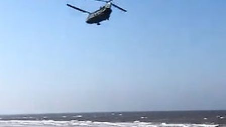 Chinook helicoper flying low over East Runton beach. Picture:Jesse Petrie-Porter