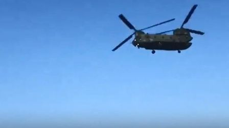 Chinook helicopter flying low over East Runton beach. Picture: Jesse Petrie-Porter