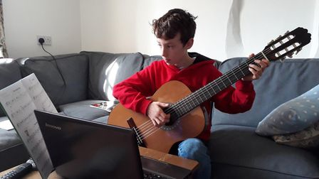 New digital school at Beeston Hall allows pupils to work from home. Henry's skype guitar lesson. Pic