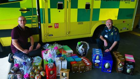 Karl Ives, left, and ambulance technician Colin Court with a donation of Easter eggs for health care