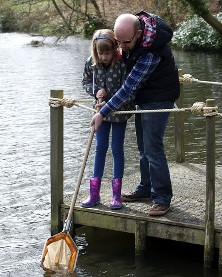 Emilia Butcher-Marroqui and Andrew Butcher do a bit of pond dipping at Holt Hall in 2015. Picture: M