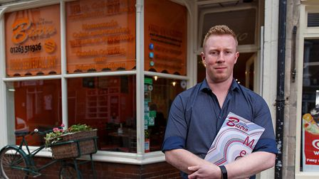 President of Cromer's Chamber of Trade, Sam Grout, outside his cafe The Old Rock Shop Bistro. Photo:
