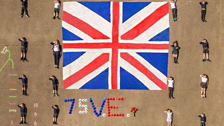 Sheringham children pay tribute to veterans on VE Day. Picture: Chris Taylor Photography