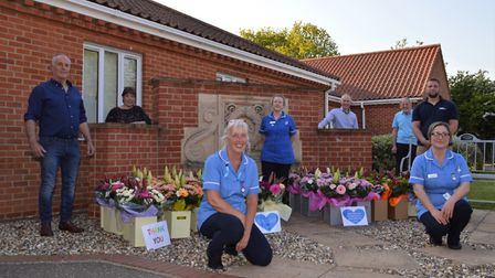 North Walsham War Memorial Hospital staff receiving the floral gifts from Daniels Transport and The