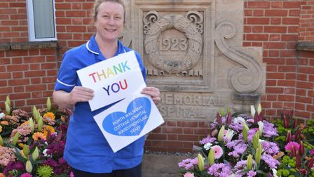 Ward sister Kerry Howarth with the floral gifts. Pictures: submitted by the Hospital Friends