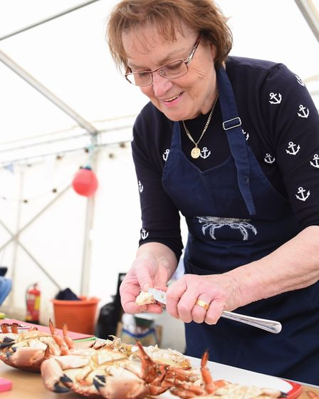 Julie Davies from the family business Davies Fish shop, demonstrates dressing a crab at the Crab and