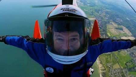 Paul Walker-Williamson enjoying the skies in his microlight aircraft above the north Norfolk coast.