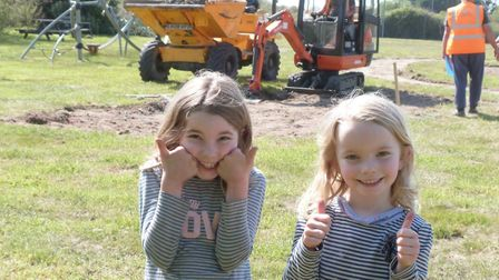 Maya, 8, and Ella Askham, 5, at the Sea Palling playground renovations. Picture: Supplied by Supplie