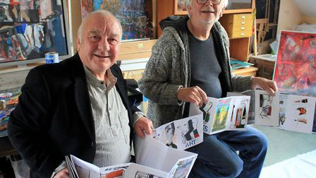 Aritsts Mike Pert (left) and John Midgley with their concertina-style book featuring more than 40 or